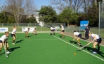 Girls playing hockey in South Africa